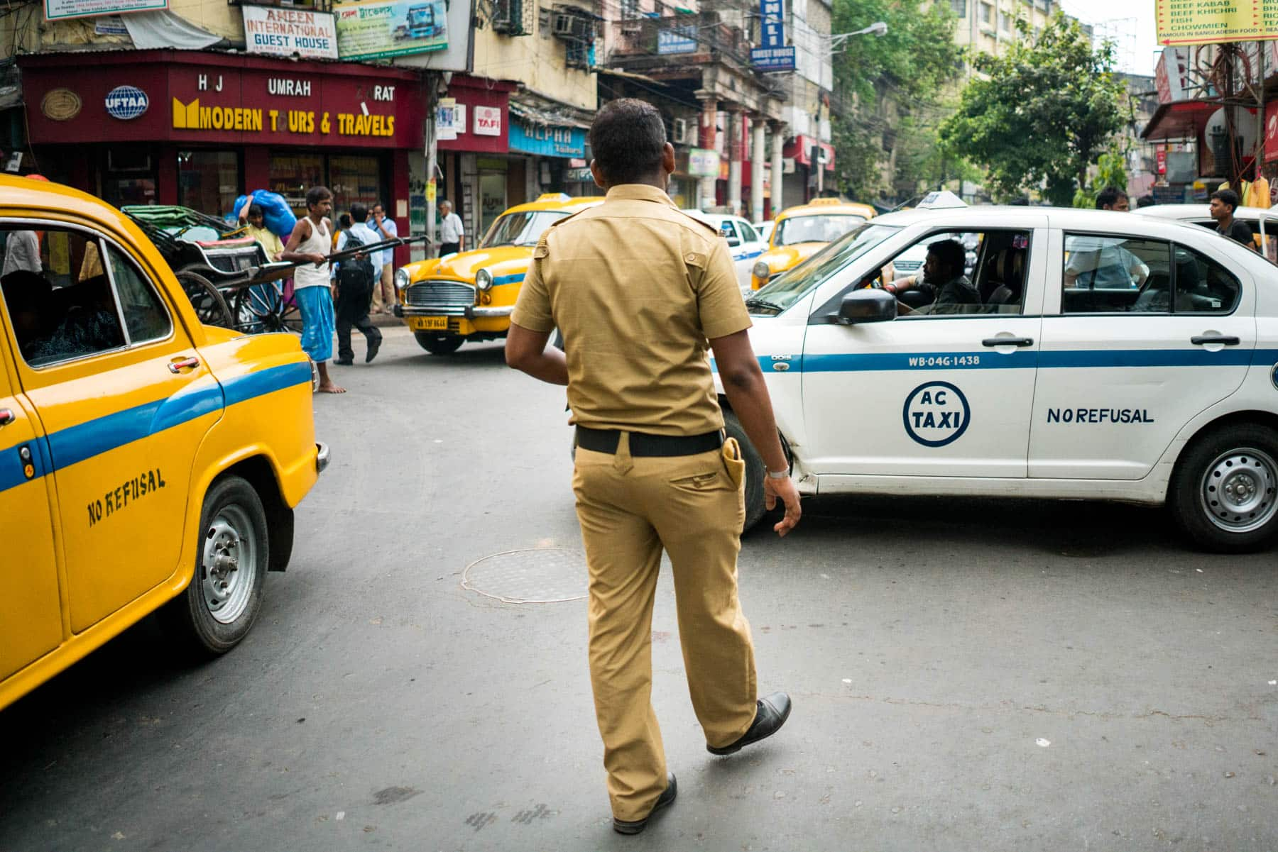 Guide to smoking weed in India - Police on the streets of Kolkata - Lost With Purpose travel blog