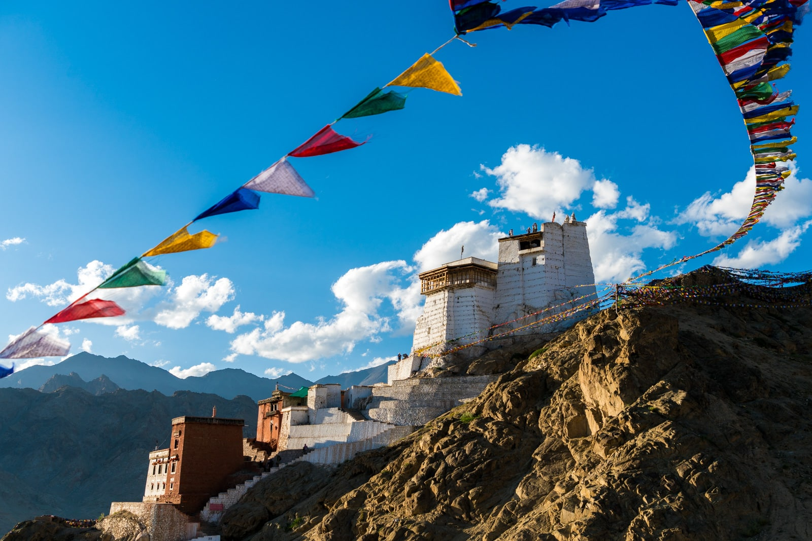 Short 3-day itinerary and guide to the Sham Valley trek in Ladakh, India - Monastery in Leh at sunset with prayer flags - Lost With Purpose travel blog