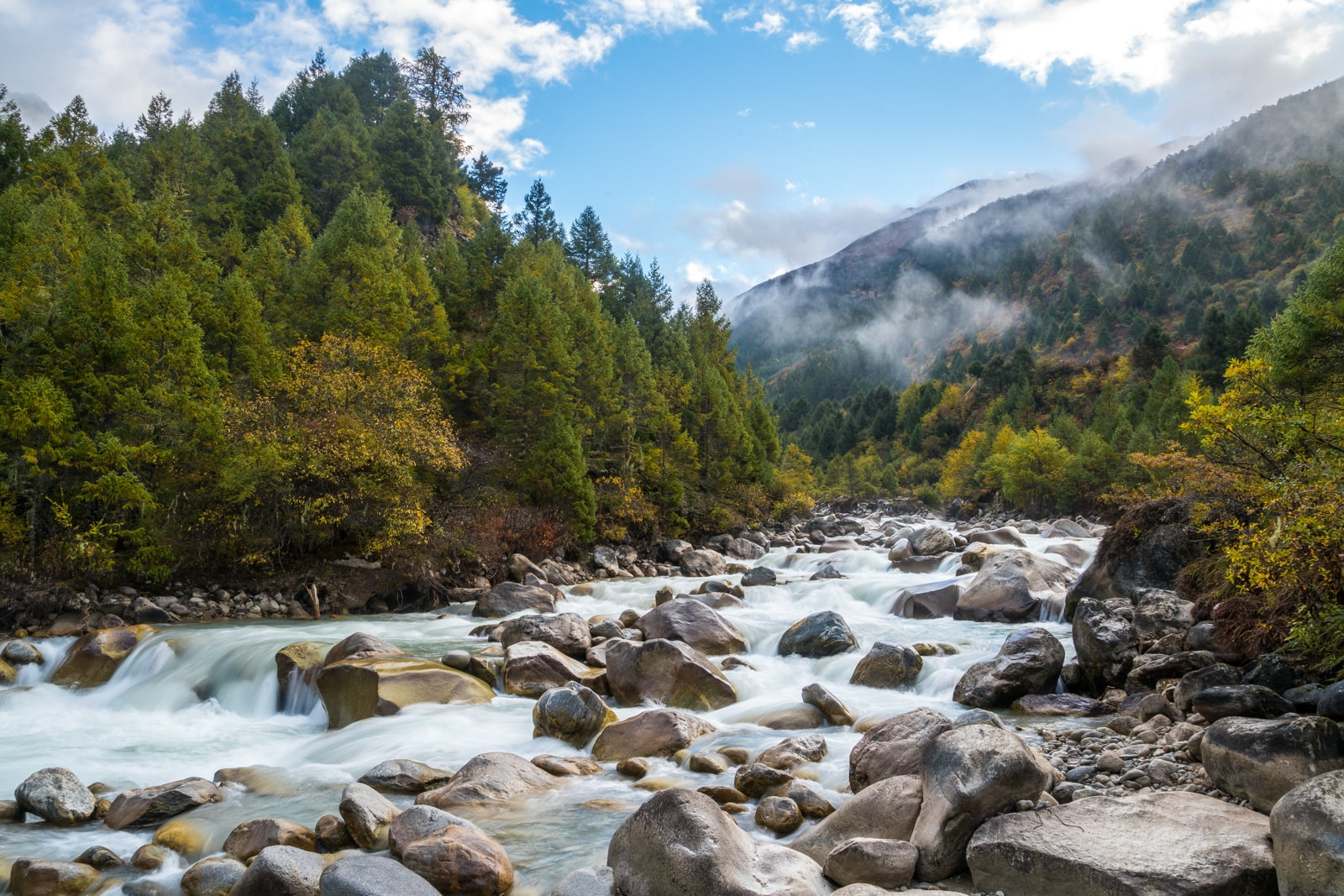 Photos of the Gasa - Laya trek in Bhutan - Long exposure of a river running past the campsite - Lost With Purpose travel blog
