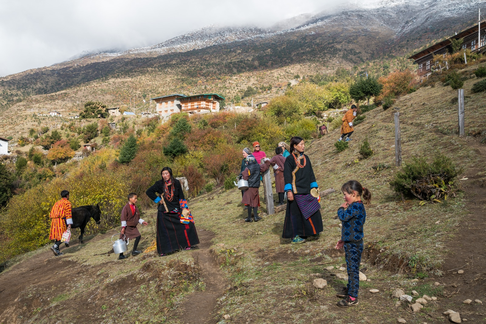 Photos of the 2017 Royal Highlander Festival in Bhutan - Locals trekking up to the Laya festival grounds - Lost With Purpose travel blog