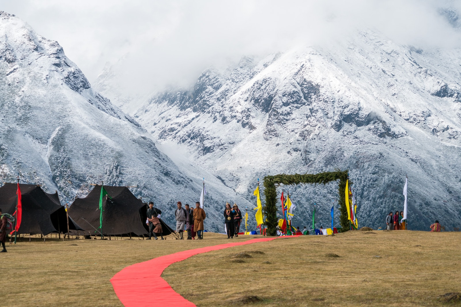 Photos of the 2017 Royal Highlander Festival in Bhutan - Entrance to the festival grounds with snowy Himalayas in the background - Lost With Purpose travel blog