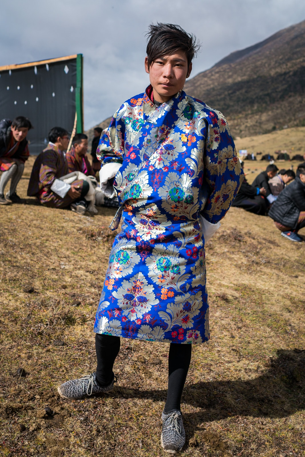 "Talk about crazy patterns! A Bhutanese boy in a silver and blue ""gho"", traditional male Bhutanese dress, at the 2017 Royal Highlander Festival in Laya, Bhutan."