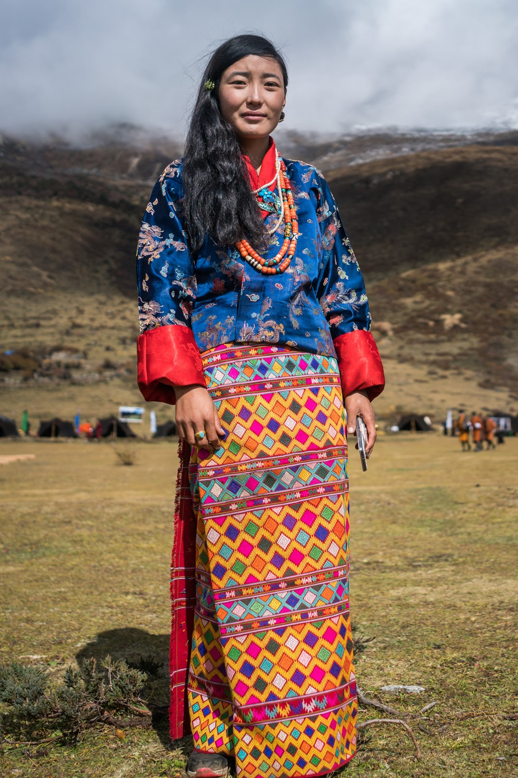 "These colors are goals! A girl in a beautiful patterned ""kira"", traditional female Bhutanese dress, at the 2017 Royal Highlander Festival in Bhutan."