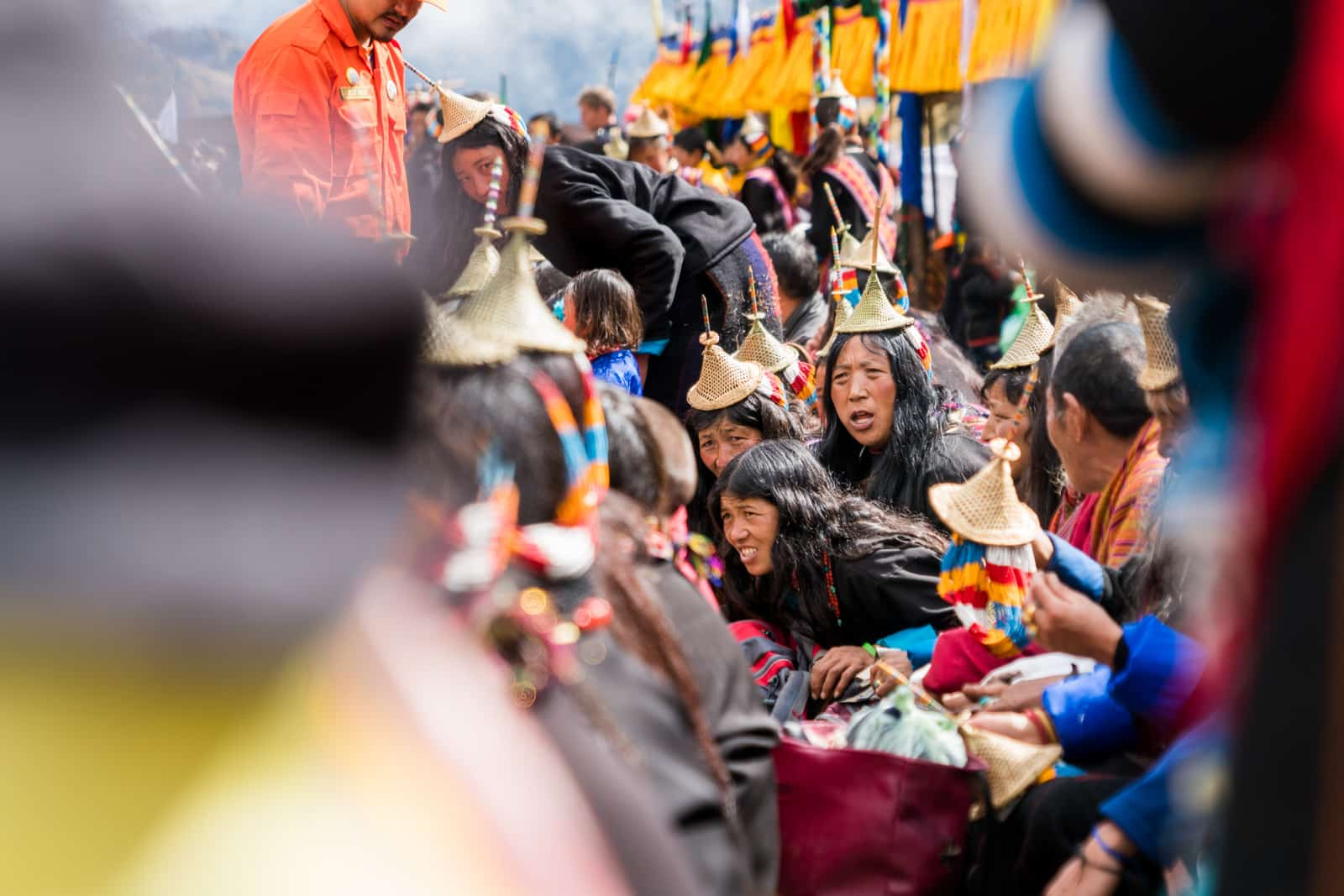 Photos of the 2017 Royal Highlander Festival in Bhutan - Local Layap ladies shouting in the crowd - Lost With Purpose travel blog