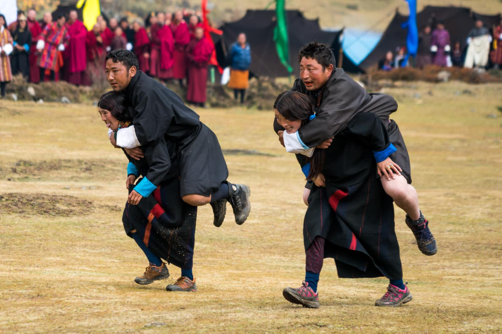 Photos of the 2017 Royal Highlander Festival - Girls carrying boys in a relay race at the Royal Highlander Festival - Lost With Purpose travel blog