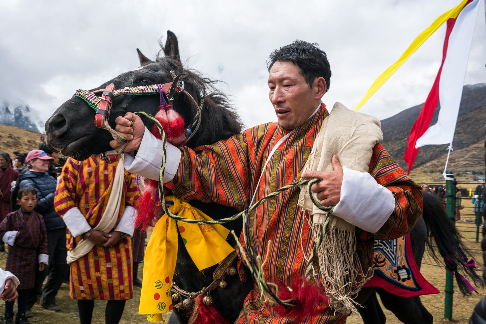 Photos of the 2017 Royal Highlander Festival in Laya, Bhutan - Man showing his horse - Lost With Purpose travel blog