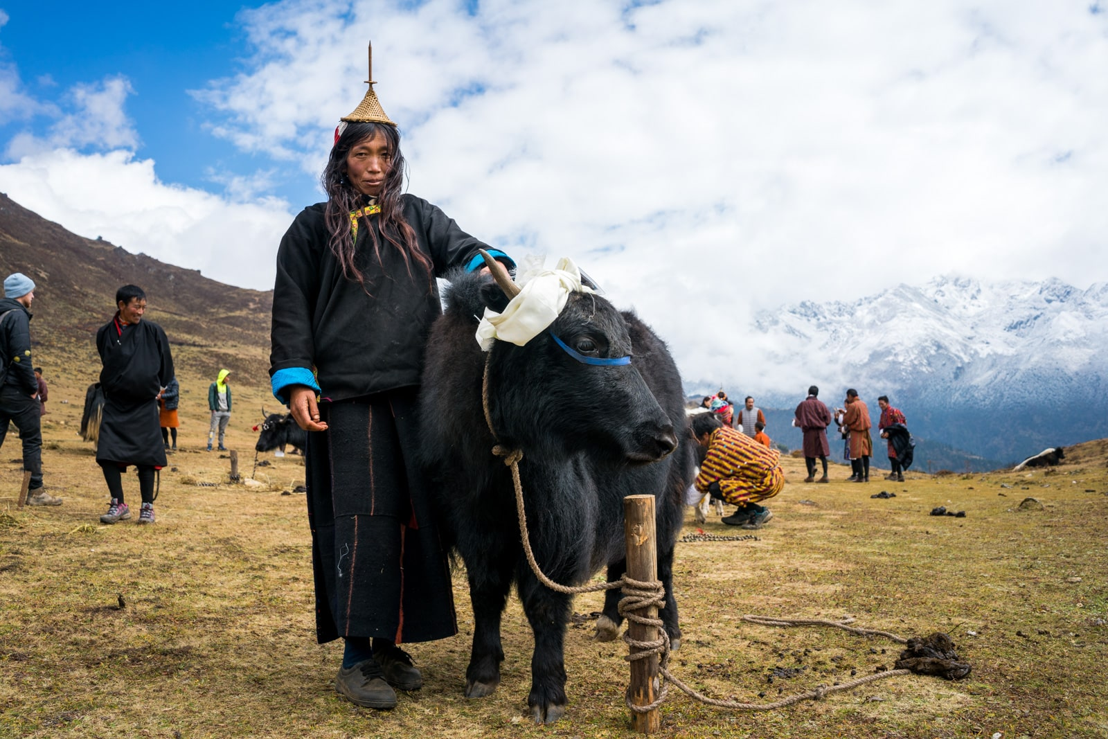 Photos from the 2017 Royal Highlander festival in Laya, Bhutan - Layap woman posing with her cow - Lost With Purpose travel blog