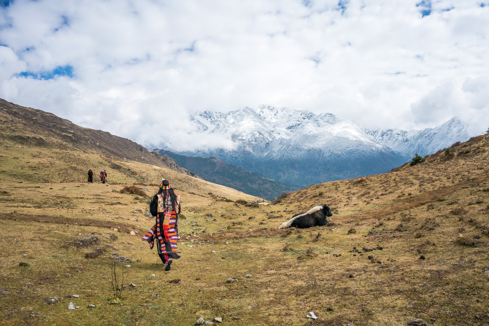 Photos of the Royal Highlander Festival in Bhutan - Layap woman in traditional clothes walking in the Himlayan mountains - Lost With Purpose travel blog