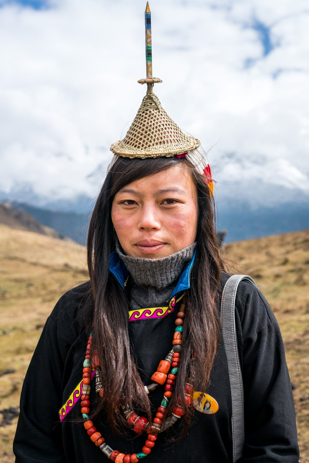 Portrait of a Layap woman in her traditional headdress and clothes at the Royal Highlander Festival in Bhutan. The festival, filled with local people in their best traditional Bhutanese dress, is a dream for anyone interested in Bhutan photography!