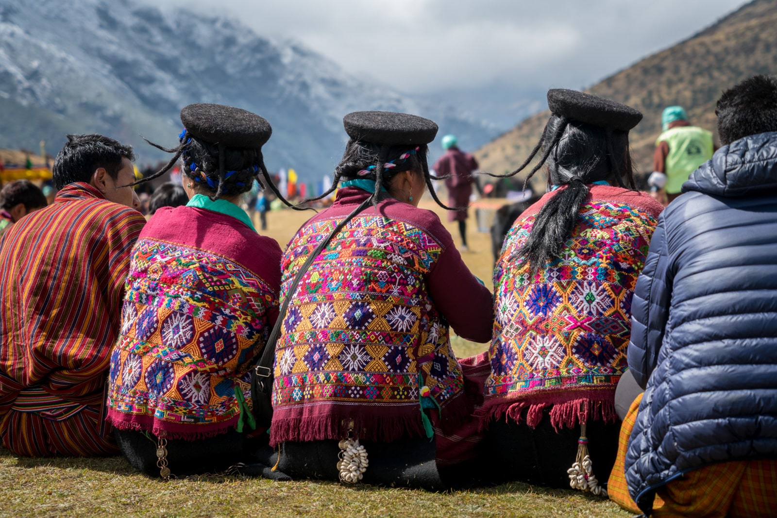 Photos of the Royal Highlander Festival in Bhutan - Monpa yak hair hats and embroidered vests - Lost With Purpose travel blog