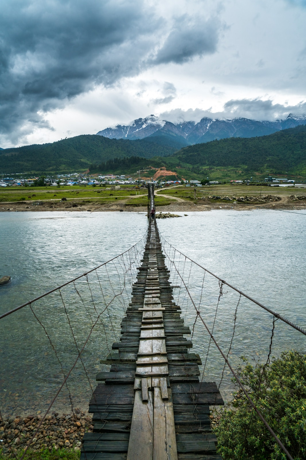 A wobbly wooden suspension bridge over a river in Mechuka, a village in Arunachal Pradesh state, Northeast India.