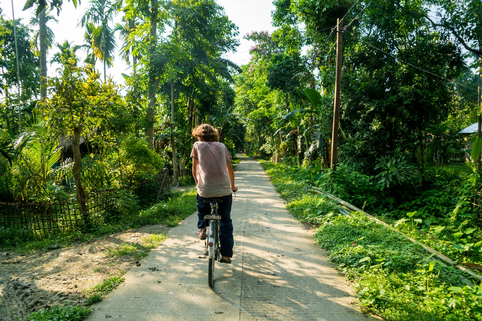 Foreign tourist cycling around Majuli river island