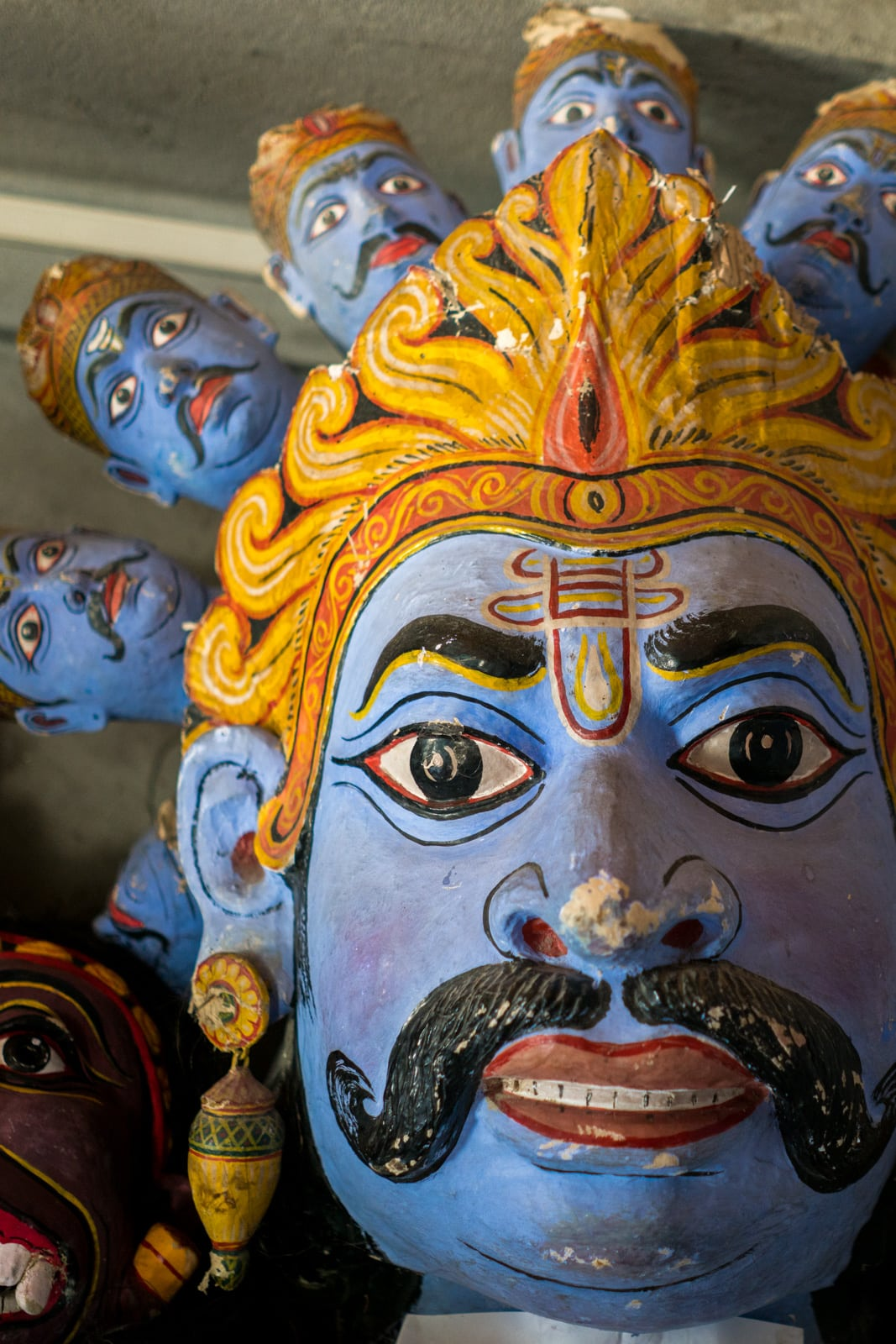 A traditional hand painted mask at one of the many Vaishnavite satras, Hindu monasteries, on Majuli river island in Assam, Northeast India.