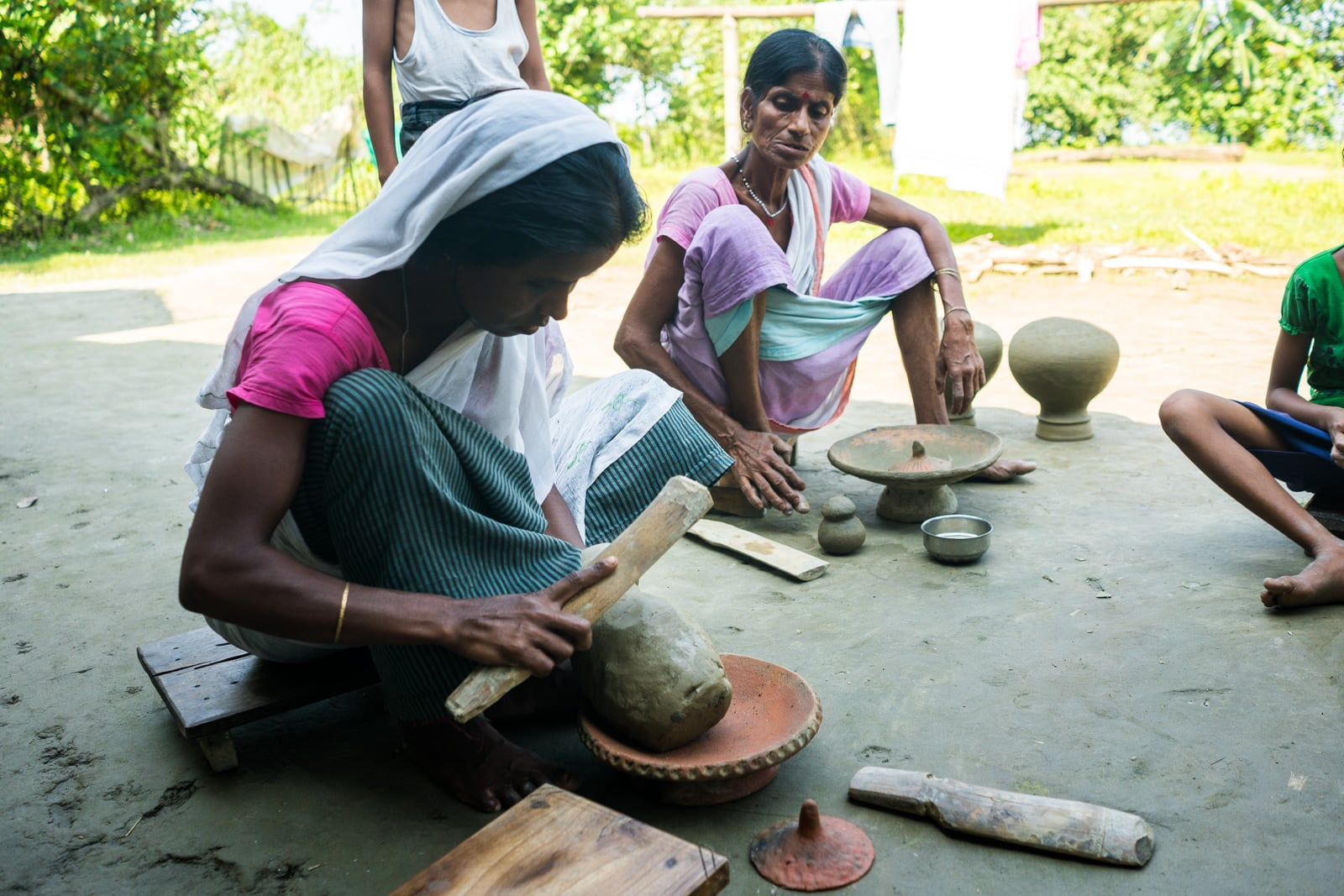Kumar women making traditional clay pots on Majuli river island