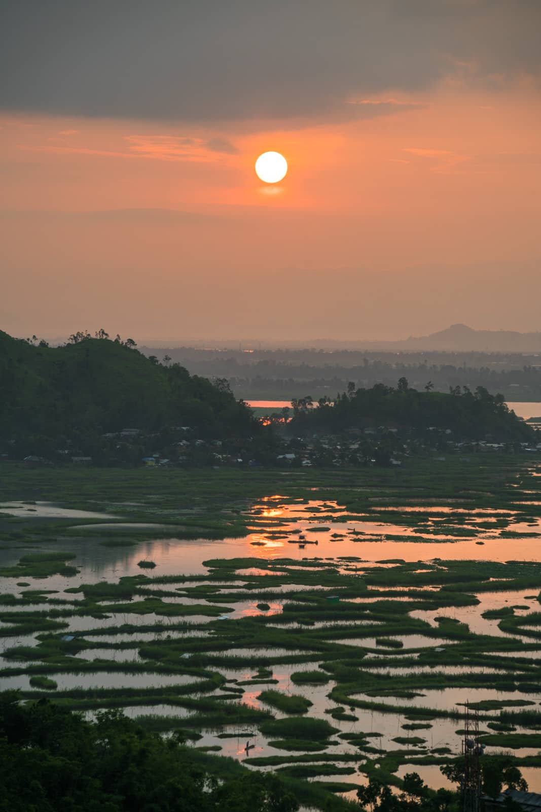 Sunrise over Loktak Lake, a peaceful offbeat destination in Manipur state, Northeast India.