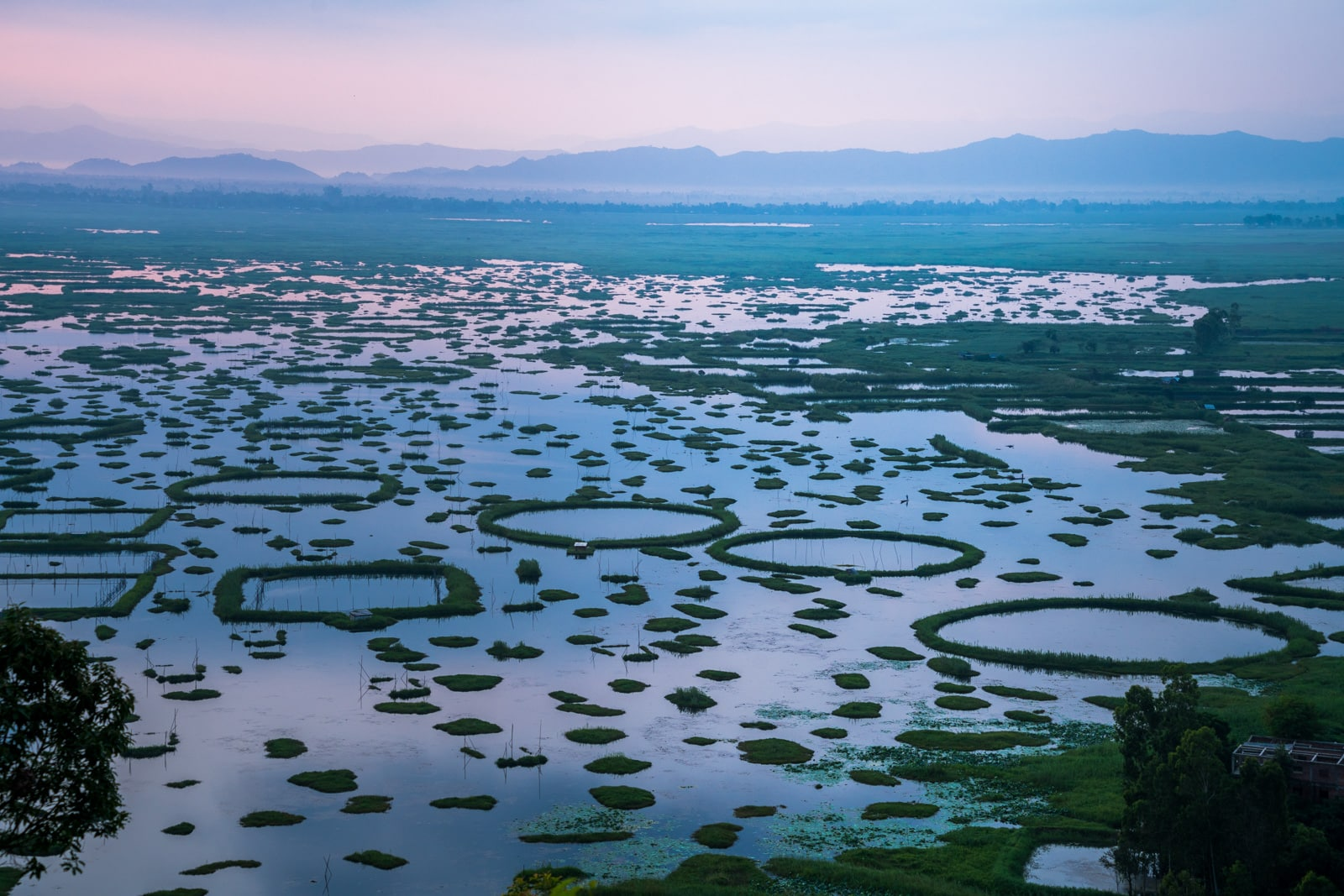 Our favorite off the beaten path destinations in India - Pastel pink sunrise over Loktak Lake in Manipur - Lost With Purpose travel blog