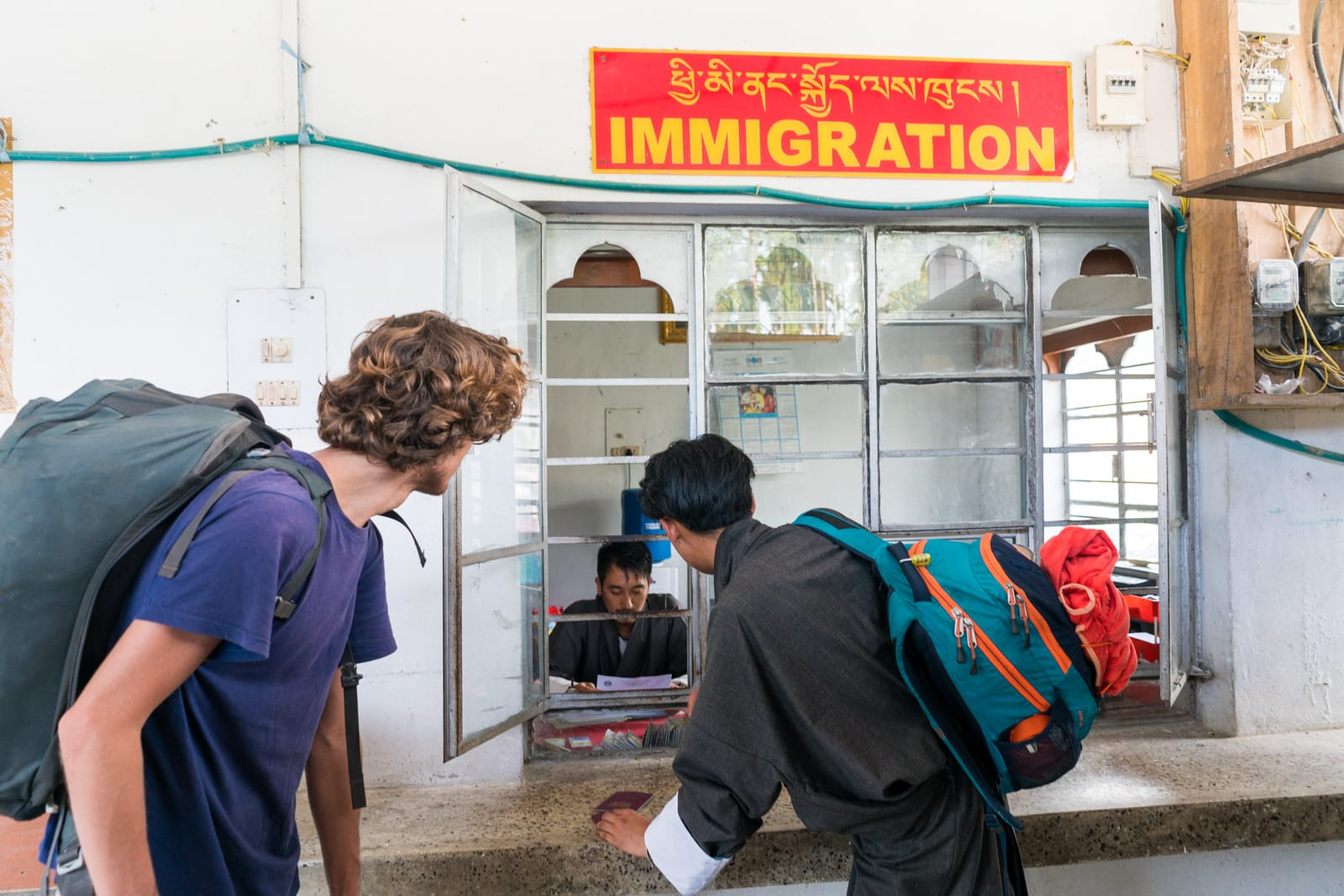 Passing through the immigration post at the India - Bhutan border crossing at Gelephu with our Gray Langur Tours guide - Lost With Purpose travel blog
