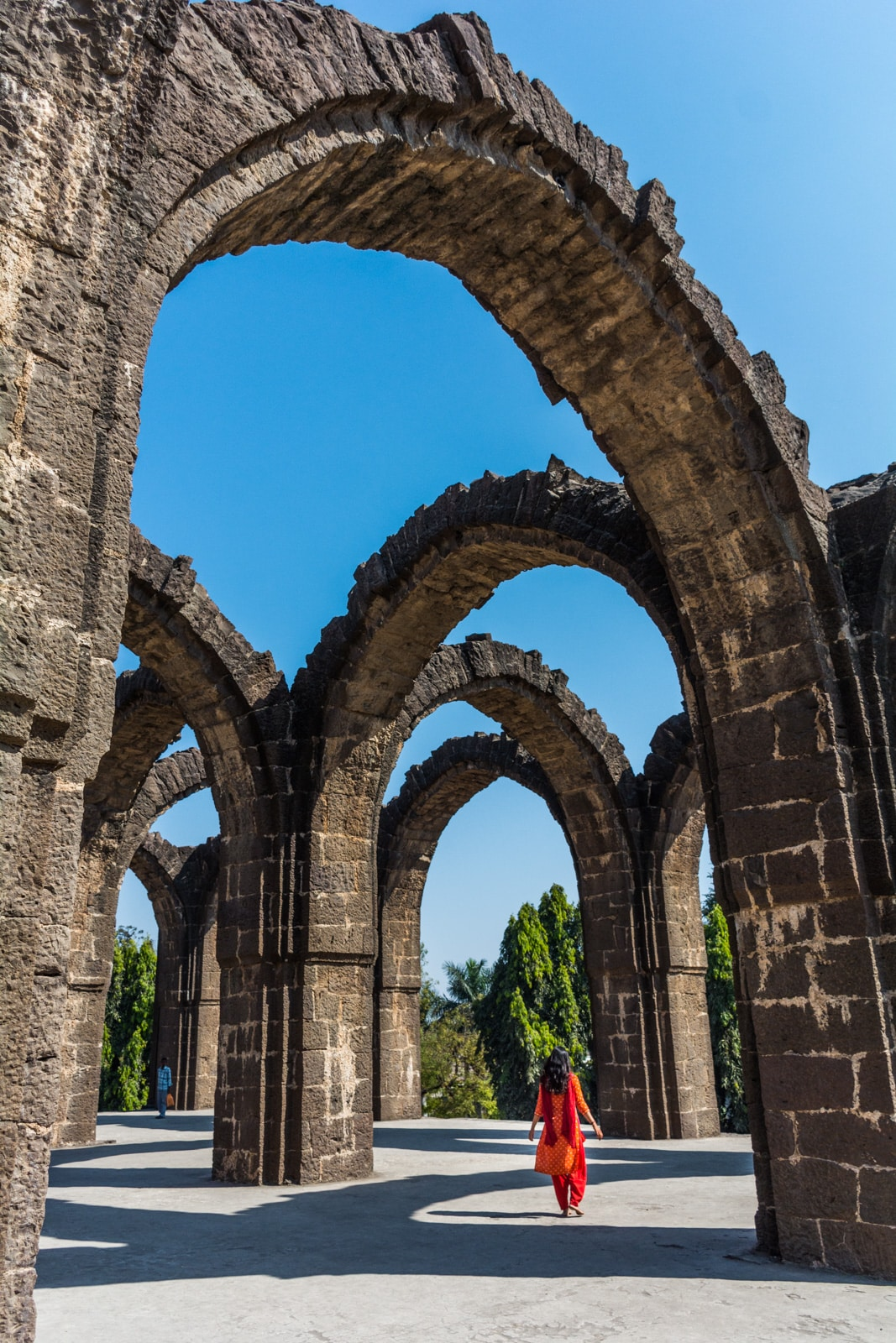 Exploring crumbling arches in Bijapur, an epic off the beaten track destination in Karnataka state, India.