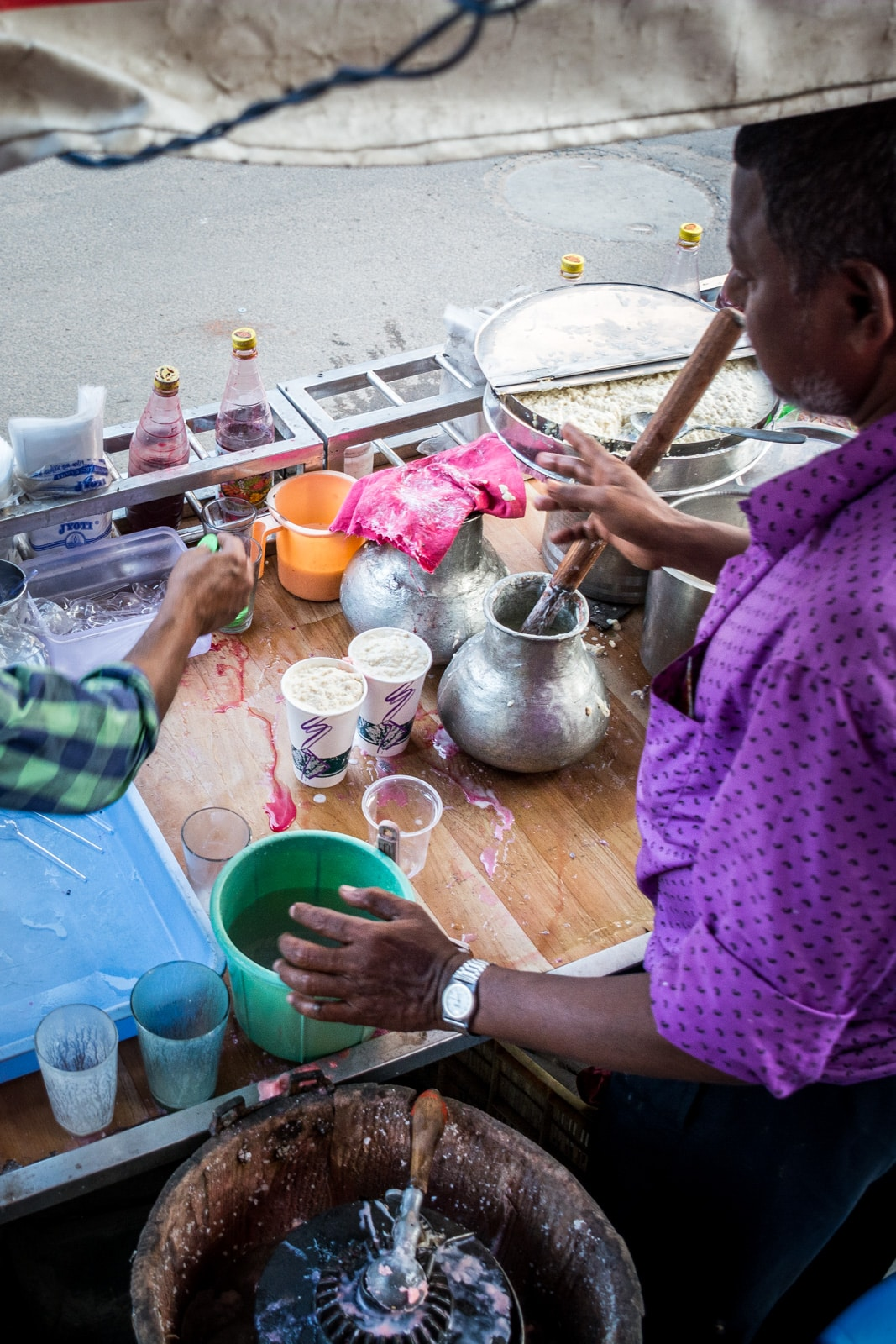 A man making lassi on the streets of Hyderabad, India.
