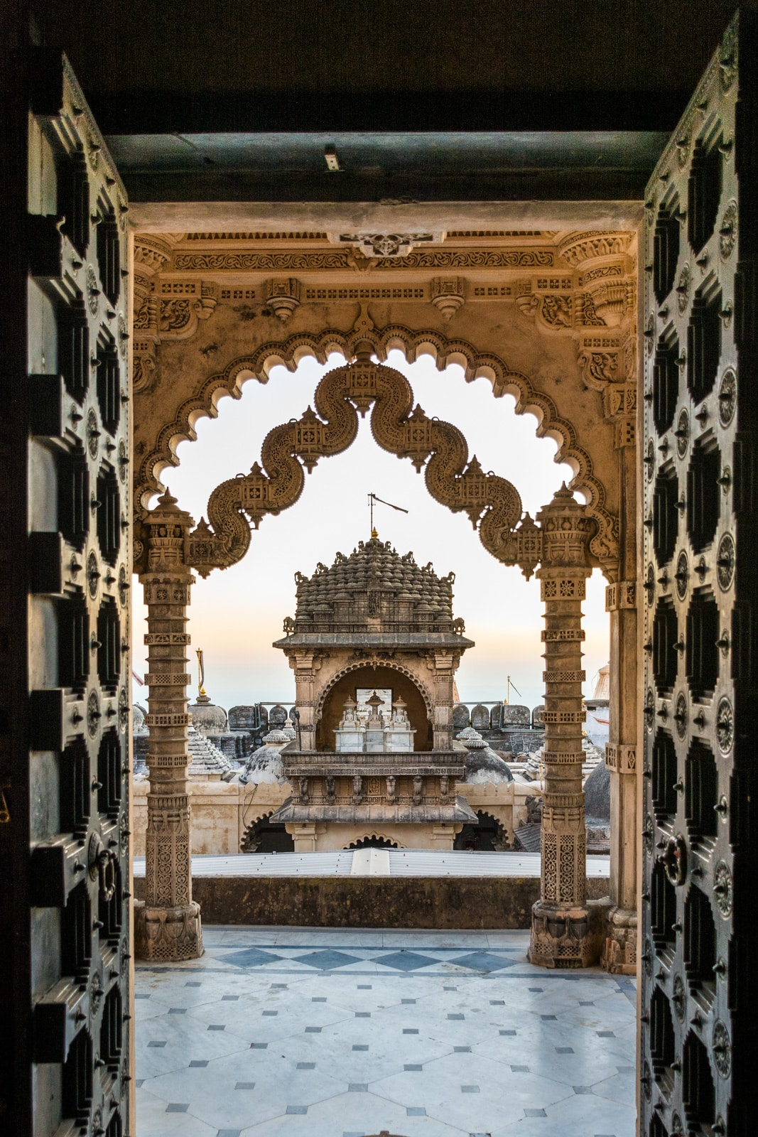 Temple doors opening to sunrise over the Jain temples of Palitana, Gujarat state, India. The perfect off the beaten track destination for your India trip!