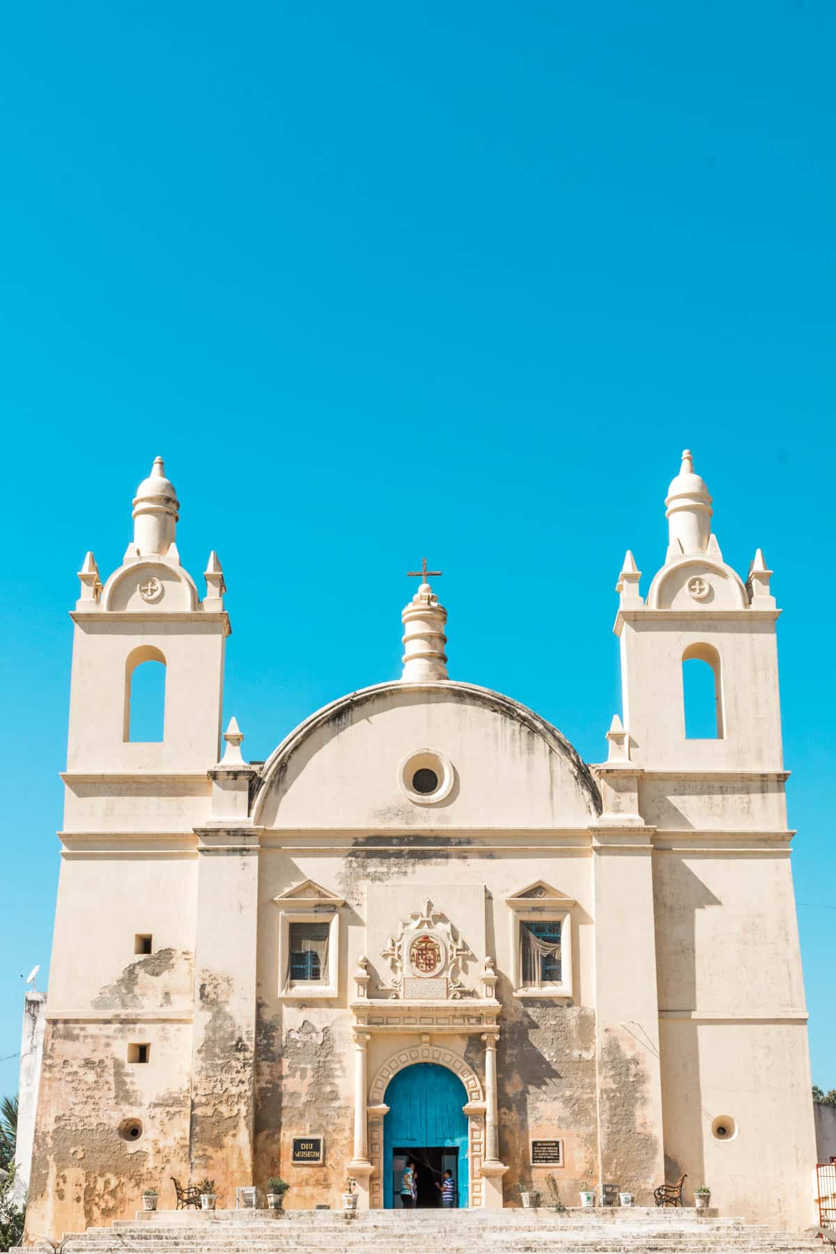 Blue skies over a Portuguese church on Diu island, India. A great off the beaten track destination in India if you're looking for a bit of comfortable rest and relaxation, and the perfect Goa alternative.
