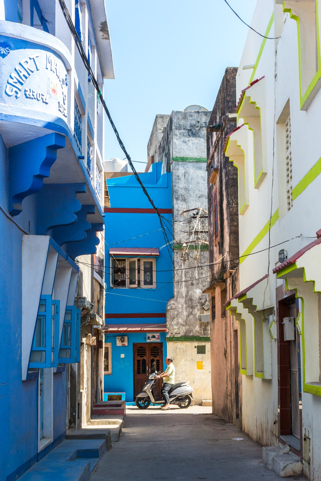 Colorful, winding backstreets of Diu, an island off the west coast of India. Portuguese-influenced Diu is a great Goa alternative if you're looking for somewhere offbeat to relax in India.