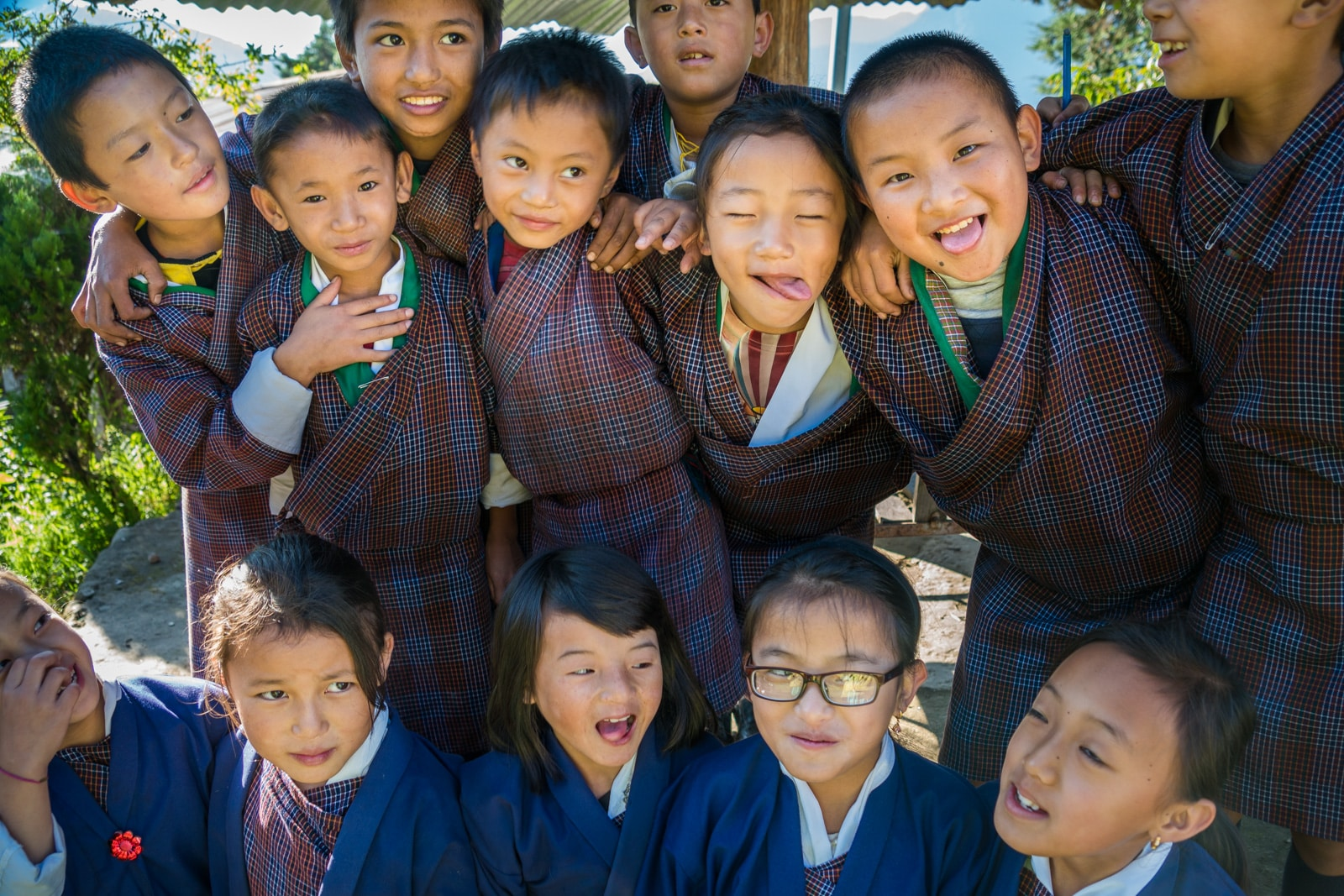 Our experience going on a guided tour in Bhutan - School children making faces in Kuengarabten - Lost With Purpose travel blog