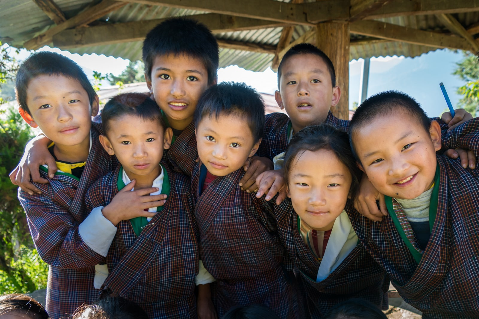 What are guided tours in Bhutan like? - Curious schoolchildren in Kuengarabten village - Lost With Purpose travel blog