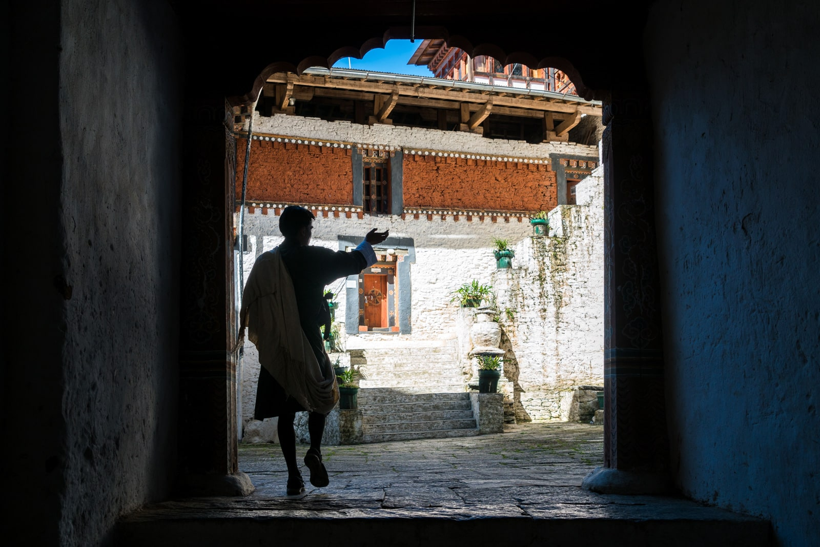 What's it like to go on a guided tour in Bhutan - Karma showing us the Trongsa dzong - Lost With Purpose travel blog