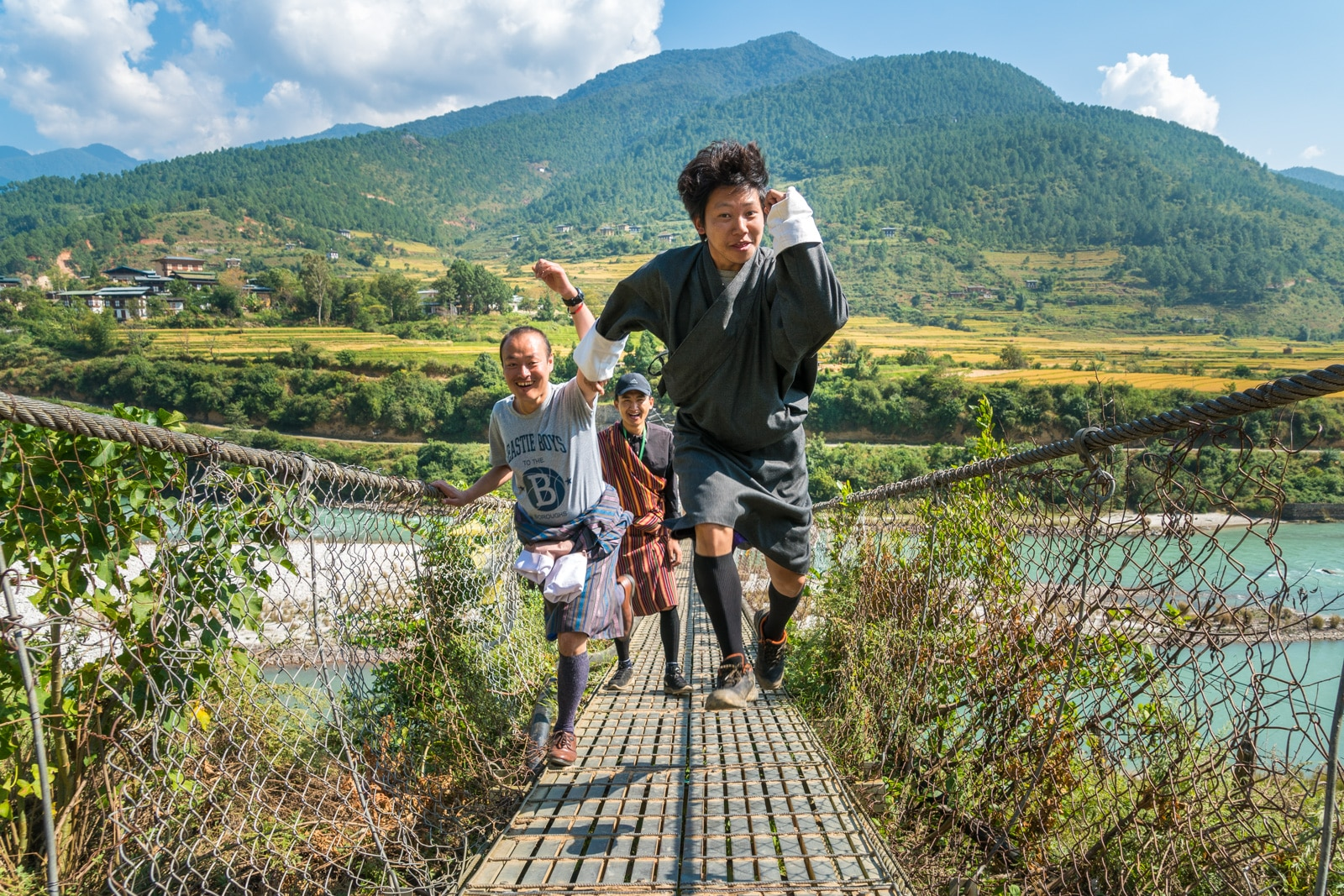 A good review of tour guides in Bhutan - Karma and the group tour guides on the suspension bridge in Punakha - Lost With Purpose travel blog