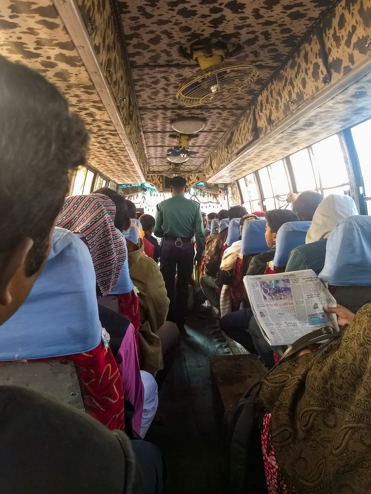 Crossing the India - Bangladesh border at Petrapole and Benapole - Police officer checking the bus - Lost With Purpose travel blog