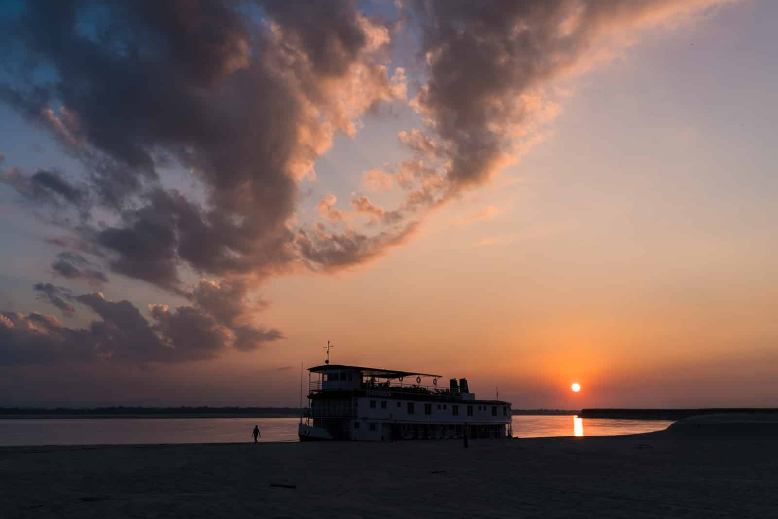 Luxury Indian river cruise on the Brahmaputra with Assam Bengal Navigation - Boat silhouette and sunset on the river - Lost With Purpose travel blog