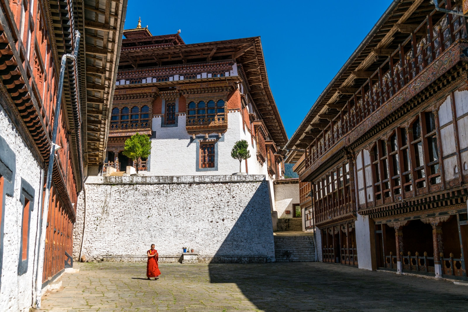 Bhutan's tourist fee - Monk walking inside the Trongsa dzong fortress - Lost With Purpose travel blog