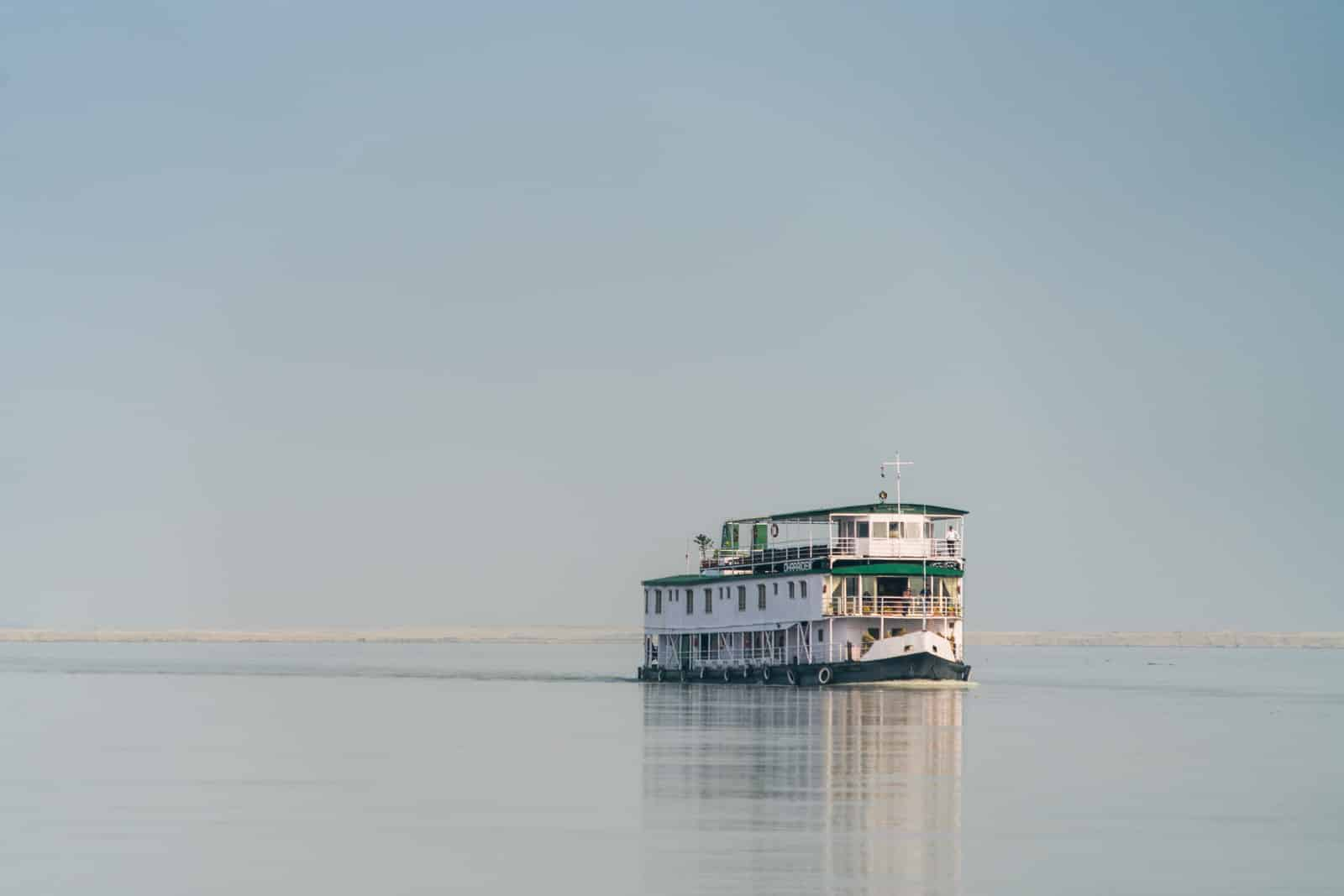 Brahmaputra river cruise with Assam Bengal Navigation - ABN Charaidew boat sailing on the water - Lost With Purpose travel blog
