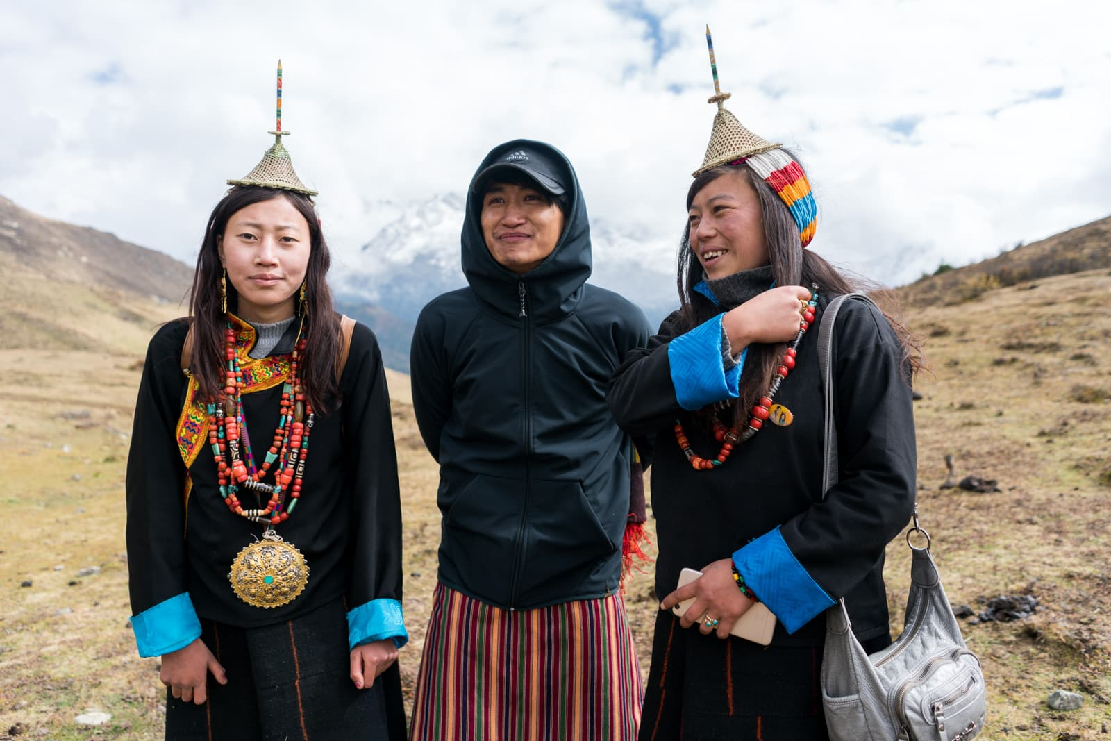 Is Bhutan worth the money? - Guide Karma posing with Layap women at the Royal Highlander Festival - Lost With Purpose travel blog
