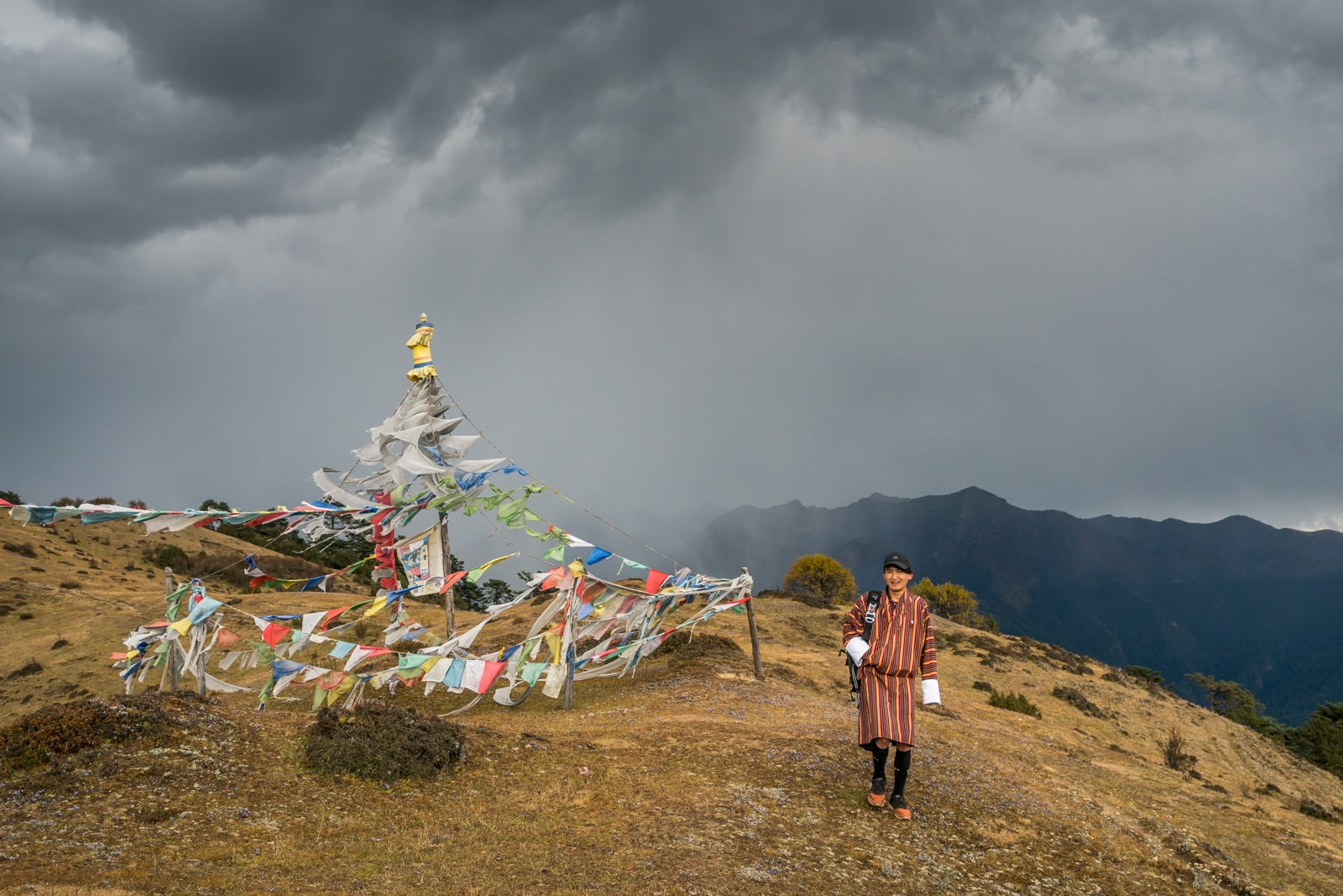 Is Bhutan worth the money - Tour guide Karma walking on the Druk Path between Thimphu and Paro - Lost With Purpose travel blog
