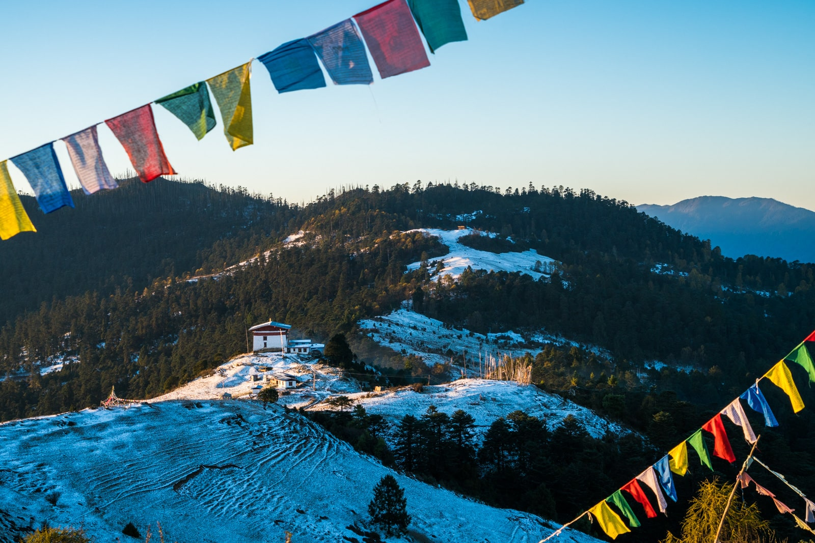 Is Bhutan worth $250 per day? - Sunrise over Jele dzong on the Druk Path in Bhutan - Lost With Purpose travel blog