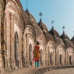 Why you should purchase travel insurance for your next trip - Girl walking through Shiva temples in Kalna, West Bengal, India - Lost With Purpose travel blog