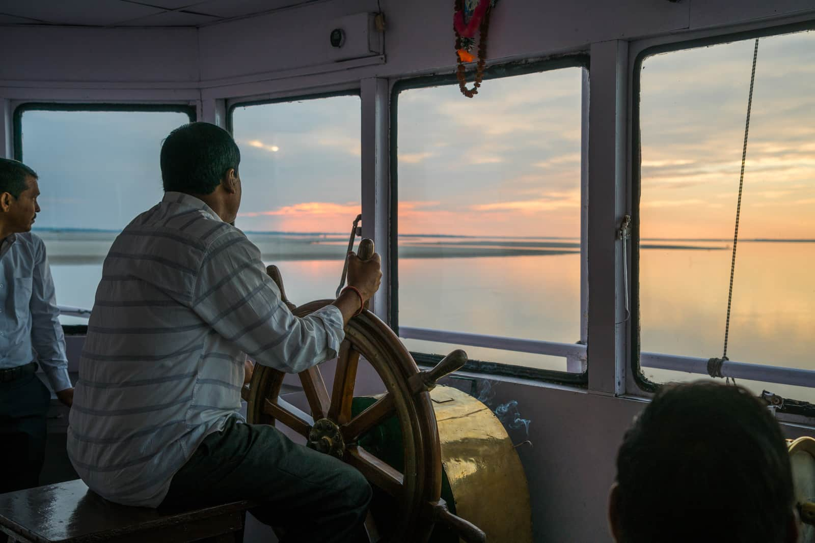 River cruising with Assam Bengal Navigation - Captain at the old steering wheel - Lost With Purpose travel blog