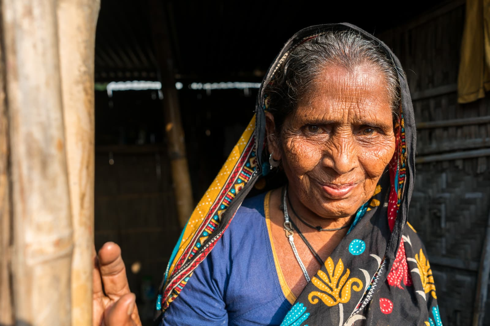 A review of a luxury river cruise in India with Assam Bengal Navigation - Old Bangladeshi woman in Khirakanta village - Lost With Purpose travel blog