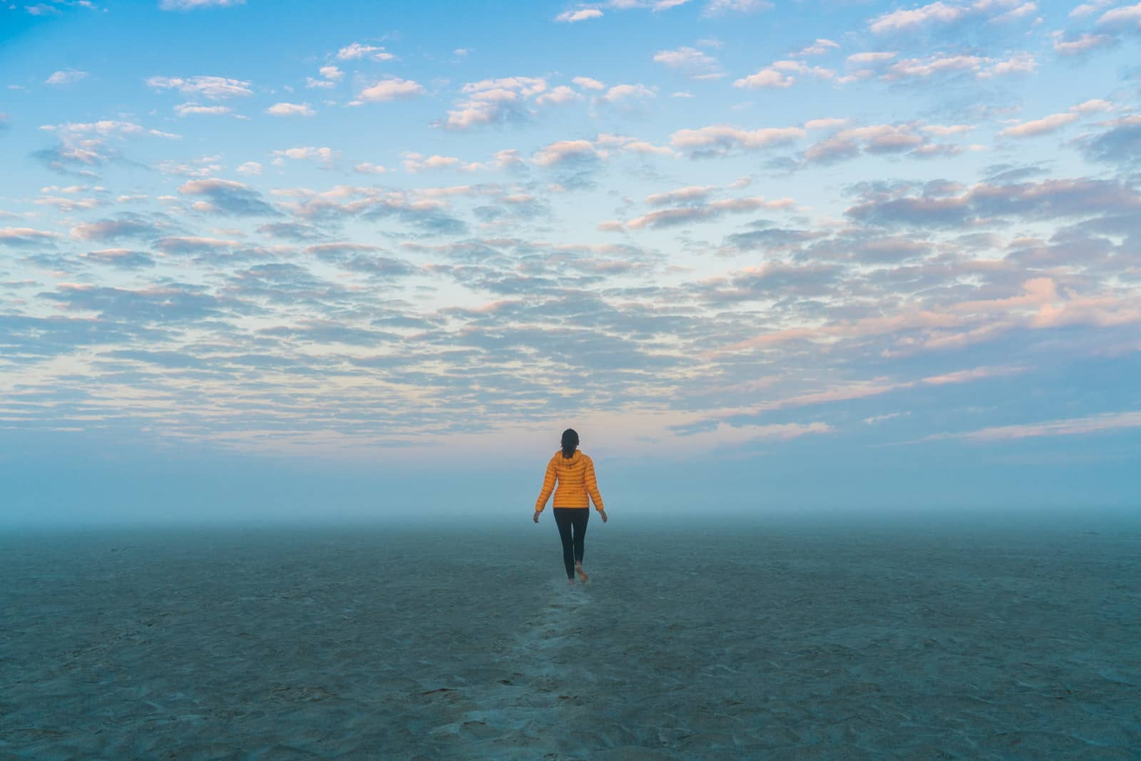 Breaking up on the road - Alex walking into the mist on the Brahmaputra river in Assam, India - Lost With Purpose travel blog