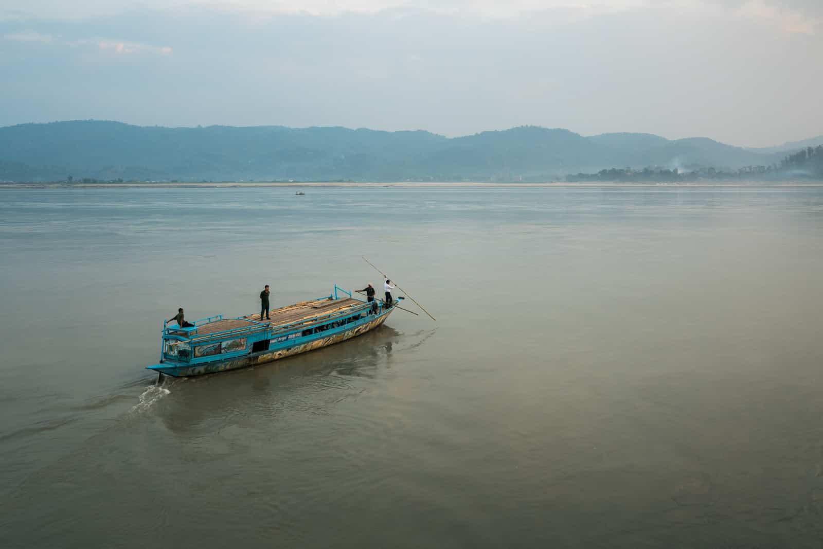 Review of my river cruise on the Brahmaputra with Assam Bengal Navigation - Country boat going out to test the water depth - Lost With Purpose travel blog