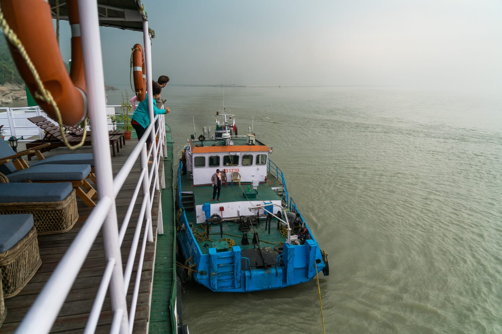 Review of a river cruise on the Brahmaputra with Assam Bengal Navigation - Tugboat pushing the cruise boat - Lost With Purpose travel blog