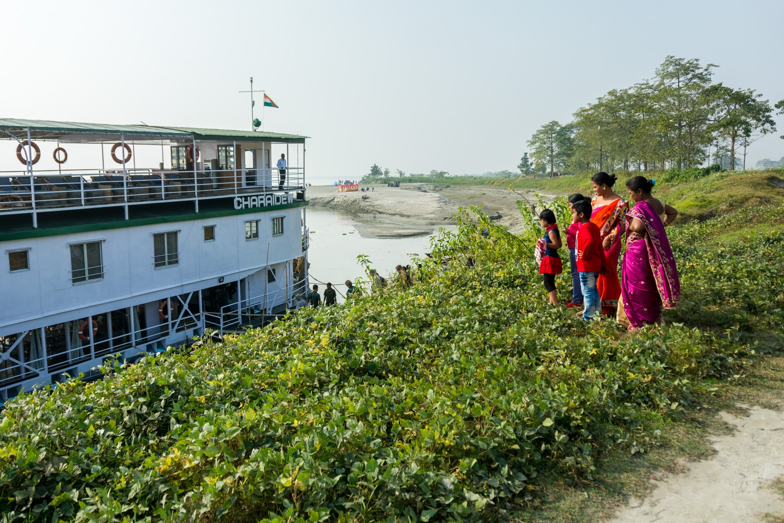 River cruise in India with Assam Bengal Navigation - Local women checking out the cruise boat - Lost With Purpose travel blog