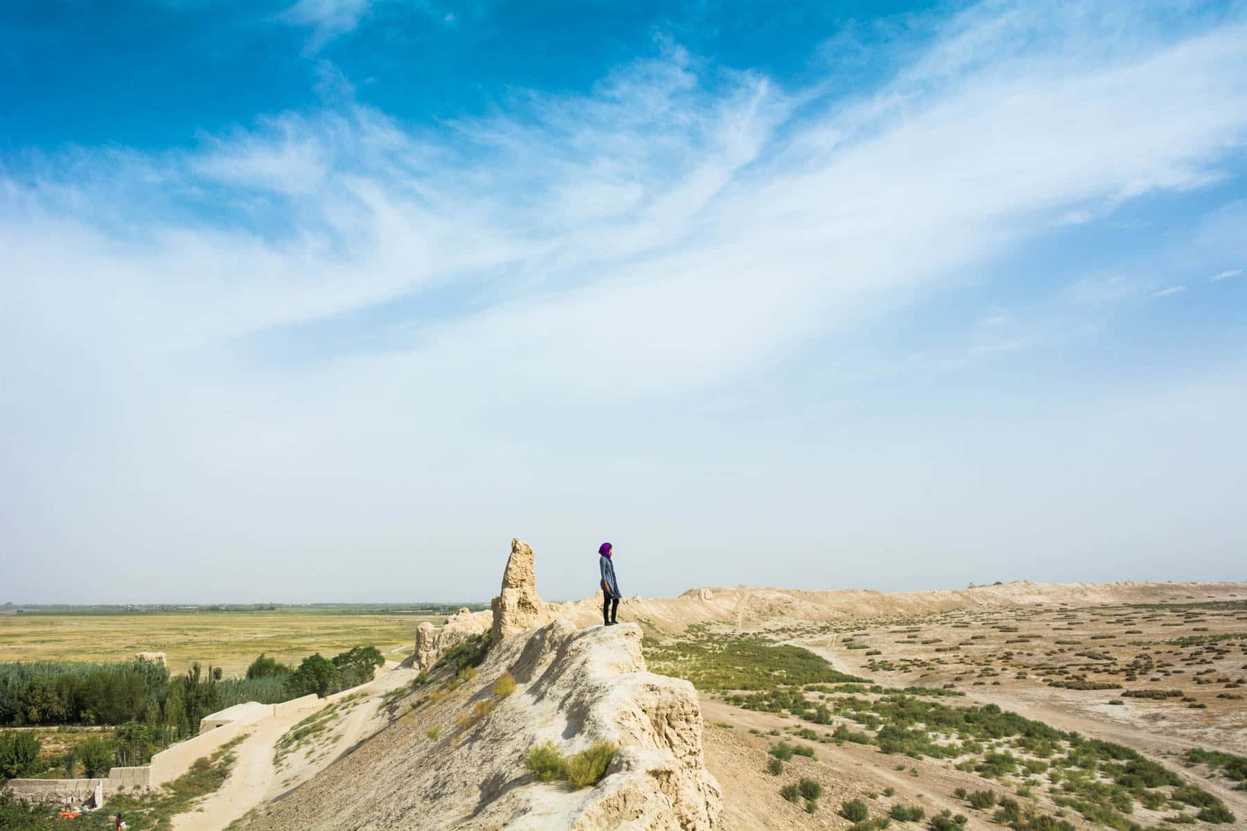 Solo female travel - Alex looking out over Balkh, Afghanistan - Lost With Purpose travel blog