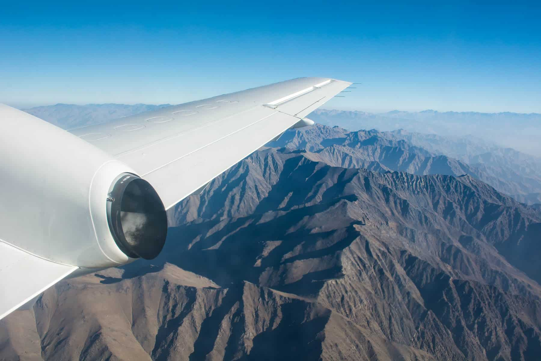 Why you should purchase travel insurance for your next trip - Plane flying over the mountains - Lost With Purpose travel blog