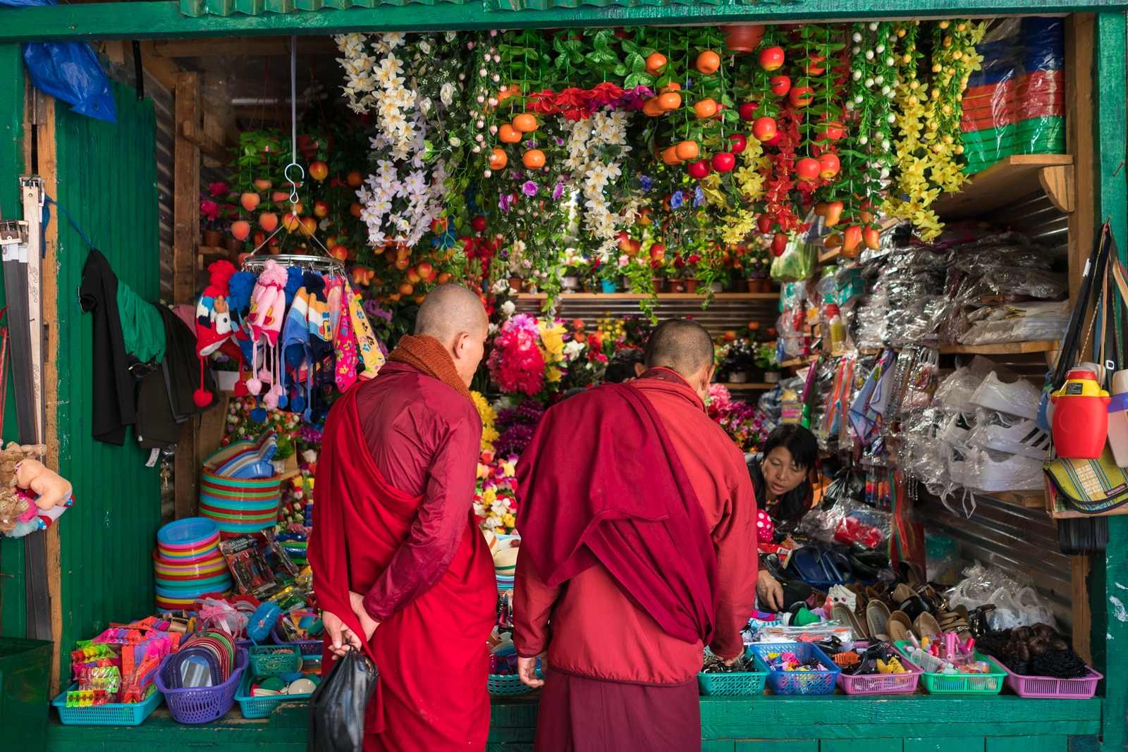 Red robed monks shopping at the handicrafts market in Thimphu