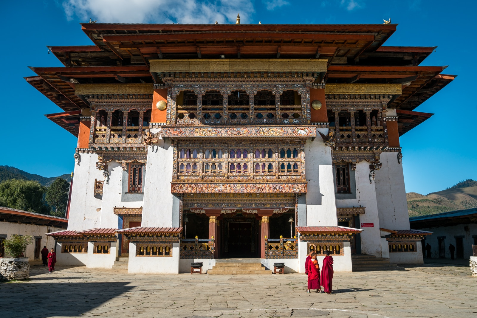 Exterior of Gangtey Monastery with monks