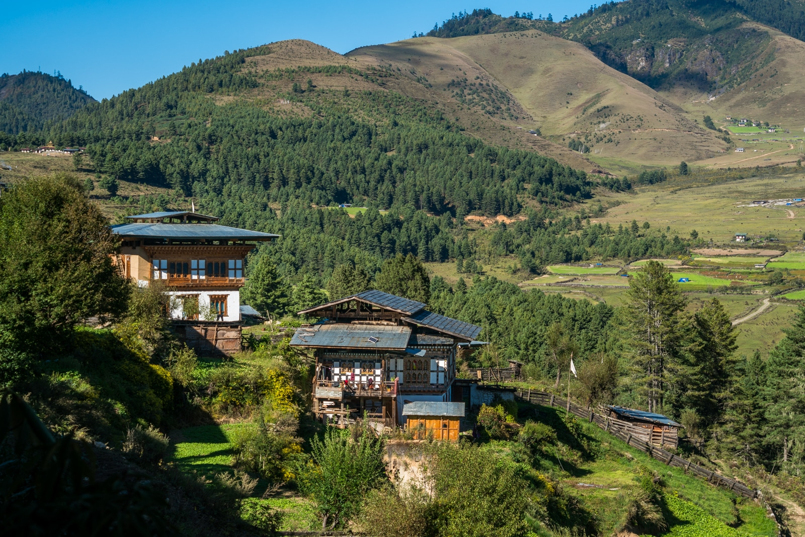 Is Bhutan worth $250 per day? - Traditional Bhutanese houses in Phobjikha Valley, close to Gangtey monastery - Lost With Purpose travel blog