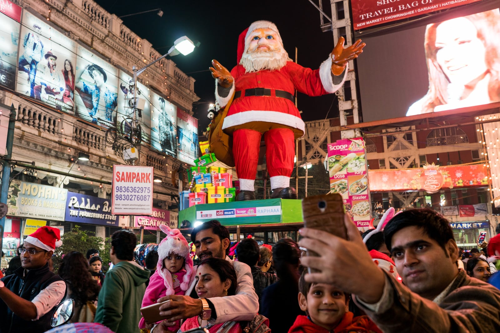 Christmas in Kolkata, India - A creepy Santa Claus statue overlooking pedestrians in the market - Lost With Purpose travel blog